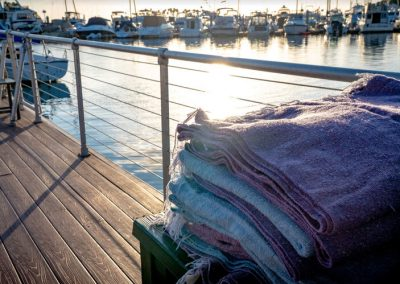 Yoga blankets stacked on Pontoon boat from Seaforth Boat Rentals
